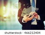 businessman holding phone | Shutterstock . vector #466212404