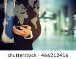 businessman holding phone   Shutterstock . vector #466212416