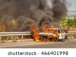 burning car on the road.... | Shutterstock . vector #466401998