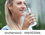 beautiful girl drinking water... | Shutterstock . vector #466502066
