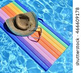 Small photo of Pool with clean water. Summer background for traveling. Hat, sun glasses on air mattress lilo.