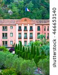 Small photo of MOLITG-LEA-BAINS, FRANCE - JULY 8, 2016: The Grand Hotel is old and elegant building, located in the heart of Mediterranean tropical park, in front of the great Pic du Canigou, 45 km from Perpignan