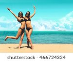 two attractive girls in bikinis ... | Shutterstock . vector #466724324