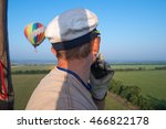 Small photo of Aeronautics. The pilot balloon. View from the balloon's basket. Amazing view from the height of the balloon. Summer beautiful fields landscape from the bird's eye, sunrise. Ballooning.