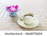 Small photo of Coffee, a cup of coffee or The long live coffee ,tasteless and unpalatable and orchid on blue ceramic bowl. Selective focus