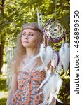 Small photo of Beauty Portrait of Girl with Dreamctahcer Hanging Alongside her