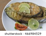 a fried fish on plate and lemon ... | Shutterstock . vector #466984529