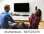young couple watching... | Shutterstock . vector #467123174