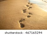 footprints at sunset with... | Shutterstock . vector #467165294