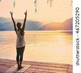 Beautiful woman practicing Yoga by the lake - Sun salutation series - Toned image