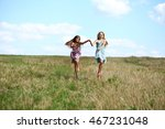 two happy little girls running...   Shutterstock . vector #467231048