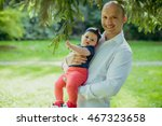 happy dad holds little daughter ... | Shutterstock . vector #467323658