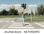 Schoolboy Crossing Road On Way...