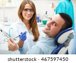 female dentists examining and... | Shutterstock . vector #467597450