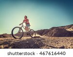 man cycling in the desert with... | Shutterstock . vector #467616440