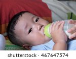 thai baby drinking milk. | Shutterstock . vector #467647574