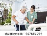 young nurse helping patient in... | Shutterstock . vector #467651099