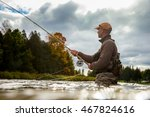 a man casts his fly rod into a... | Shutterstock . vector #467824616