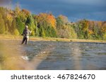 A Man Casts His Fly Rod Into A...