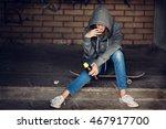 teen girl in hood holding a... | Shutterstock . vector #467917700