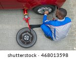 Young African Mechanic Changin...