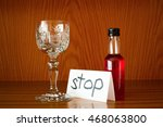 Small photo of Glass, bottle with alcohol and paper with text STOP. Appeal to overcome addictive alcohol abuse and dependence through detoxifiction, treatment, rehabilitation and abstinence