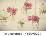flowers in jars on a string. | Shutterstock . vector #468090314