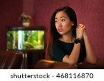 asian woman relaxing indoors | Shutterstock . vector #468116870