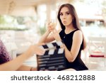 Small photo of Surprised Actress Holding a Glass in Movie Scene - Portrait of funny girl acting in a commercial