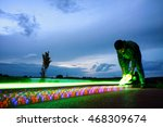Young boy holding lighting skateboard before speed movement captured as light in dark evening. Motion on long exposure. - stock photo
