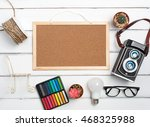cork board and Stationary,polaroid camera top view on wooden white table