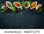 herbs and spices over black... | Shutterstock . vector #468371270