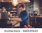 handsome barista preparing cup... | Shutterstock . vector #468539633