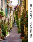 Small photo of picturesque alley with entwined houses in Antibes, Cote Azur, France