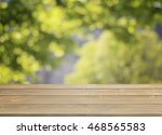 wood table top and blurred... | Shutterstock . vector #468565583