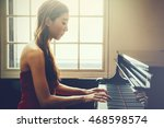 asian woman playing piano in... | Shutterstock . vector #468598574
