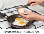 fried egg in a frying pan | Shutterstock . vector #468608726