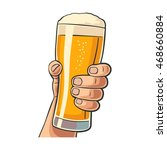 male hand holding a beer glass. ...   Shutterstock .eps vector #468660884