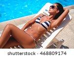 Girl Lying And Sunbathing By...