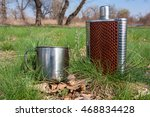steel can and flask on meadow... | Shutterstock . vector #468834428