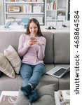smiling young woman at home... | Shutterstock . vector #468864584