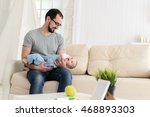 dad playing with baby | Shutterstock . vector #468893303