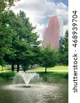 Small photo of Sam Houston Park, small pond with fountain. Texas, US