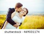 groom hugs bride tightly from...   Shutterstock . vector #469031174