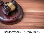 gavel on wooden background.