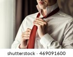 man in shirt dressing up and...   Shutterstock . vector #469091600