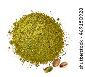 Small photo of Pistachio powder pile with pistachios from top on white background