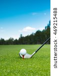 Small photo of Golf ball and golf club on the course with beautiful background