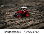 Small Toy Tractor On The Field
