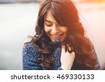 Stock photo shy girl standing looking down young woman being shy on lake background film effect 469330133